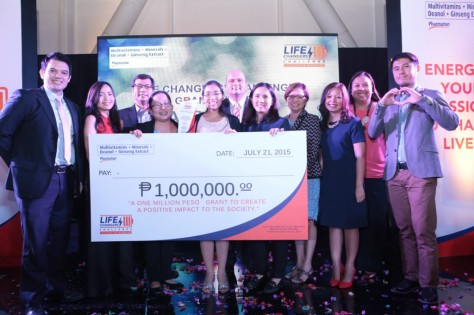 """The ladies of ""Oras na Para sa Alpabasa"" were all smiles after being named as the ultimate life changers during Tuesday night's awarding ceremonies for Pharmaton's ""Life Changers Challenge: Success in Numbers"" campaign at the Century City Mall Event Space. The group endeavors to nurture their passion and impact the lives of more Filipinos by equipping teachers, schools, and classrooms to teach reading to kindergarten and elementary school children. With the kids' best interest at heart, Alpabasa eyes to change lives, one syllable at a time. Seen in the photo together with the winners are (L-R): Pharmaton Life Changers Chef Rob Pengson and Reese Fernandez; BIPHI's Director of Consumer Health Care, Mr. Ricky Rivera; Boehringer Ingelheim Head of Finance, Mr. Andreas Meneghetti (6th from left); BIPHI Head of Medical, Dr. Editha I. Arceo Dalisay (4th from left); Pharmaton Senior Brand Manager Bernice Jalgalado; Boehringer Ingelheim Group Manager, Mely Guerrero; and Futkal founder and Pharmaton Life Changer Peter Amores."" (Photo and caption courtesy of Pharmaton)"
